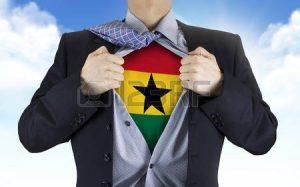 40708326-businessman-showing-ghana-flag-underneath-his-shirt-over-blue-sky