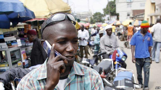 Nigerian-making-a-call